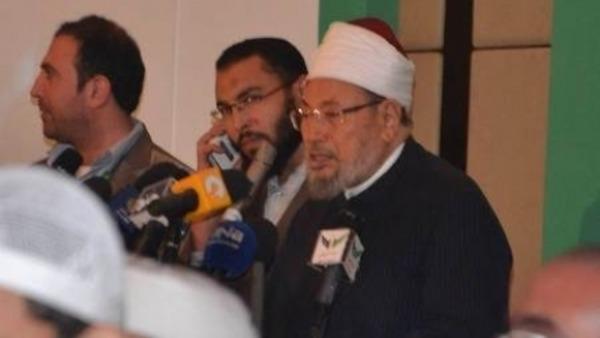 الشيخ يوسف القرضاوي أثناء إلقاء كلمته