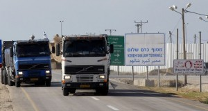 Trucks transporting humanitarian aid for the Gaza Strip leave the Kerem Shalom crossing after their entrance into Gaza was denied by Israeli authorities on November 13, 2008. The United Nations will suspend its food distribution to half of Gaza's 1.5 million people today after Israel failed to allow emergency supplies into the Palestinian territory, a spokesman said. Israel initially said it would allow 30 trucks to deliver supplies to Gaza today after it completely sealed off the Gaza Strip on November 5, but later said mortar fire by Gaza militants made it impossible to do so.  AFP PHOTO/DAVID BUIMOVITCH (Photo credit should read DAVID BUIMOVITCH/AFP/Getty Images)