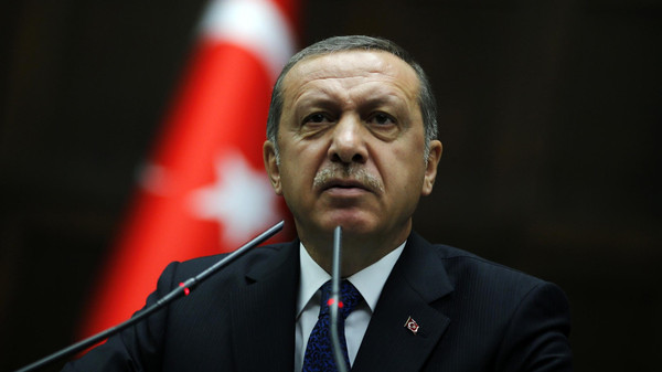 Turkey's Prime Minister Tayyip Erdogan addresses members of parliament from his ruling AK Party (AKP) during a meeting at the Turkish parliament in Ankara June 3, 2014. Erdogan, who has criticised the central bank for not cutting interest rates enough, said he did not accept Governor Erdem Basci's approach on rates and hoped the bank would act immediately to resolve the issue. Speaking to reporters a day after Basci briefed the cabinet on central bank policy, Erdogan said the latest data showed that inflation was not falling. REUTERS/Umit Bektas (TURKEY - Tags: POLITICS BUSINESS)