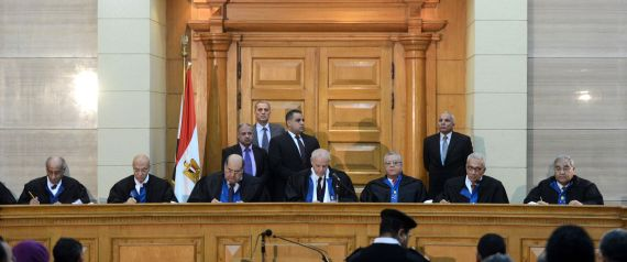 "Members of Egypt's constitutional court hold a session to rule on the law organising the upcoming parliamentary elections on March 1, 2015 in the capital Cairo. The administrative court, which rules on state related matters, ruled that parts of the law organising parliamentary elections starting March 21 violate the charter. President Abdel Fattah al-Sisi ordered that the law be redrafted within a month and asked that ""legal measures be undertaken to avoid delaying"" the election, his office said. AFP PHOTO/ MOHAMED EL-SHAHED (Photo credit should read MOHAMED EL-SHAHED/AFP/Getty Images)"