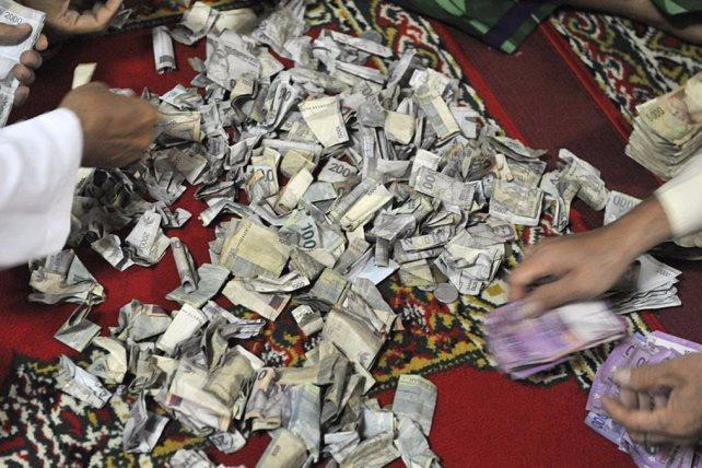 زوجين استولى على 2.5 مليون جنيه من الأهالي بأبوحماد لتوظيفها