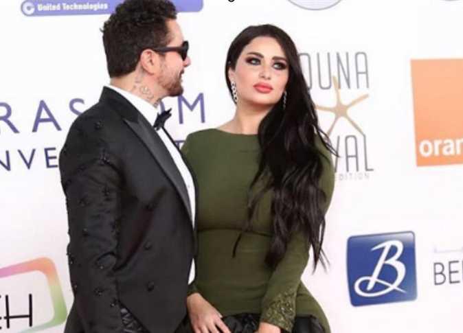 أحمد الفيشاوي مع زوجته بمهرجان القاهرة السينمائي