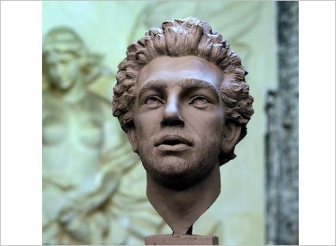A young man sculpts a new statue of Mohamed Salah